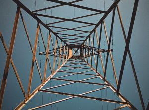 grey metal bridge under blue sky during daytime