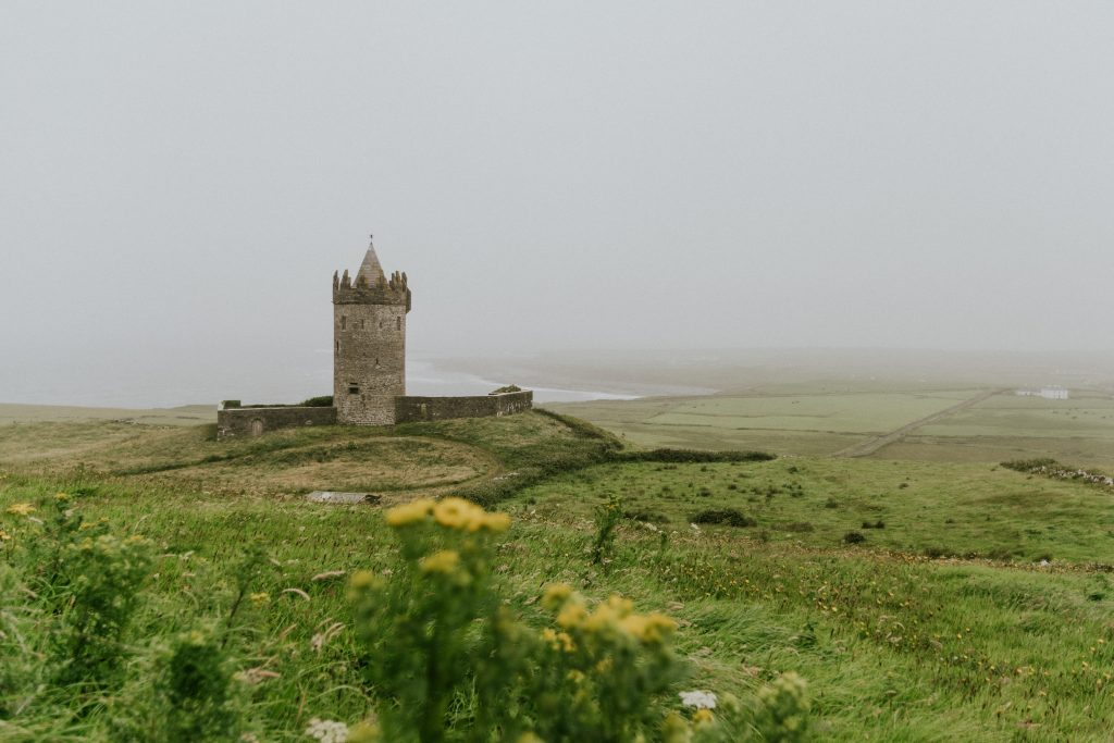 gray Ireland: Relaxing Guided Tours of Irelandstructure surrounded by green trees